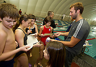 """Swimmer Ian THORPE (R) of Australia is doing autographs at the temporary covered 50m outdoor pool at the Centro sportivo nazionale della gioventu (""""youth and sports""""-Centre) in Tenero, Switzerland, Wednesday, March 16, 2011. Five-time Olympic gold medallist Ian Thorpe has finalised his coaching set-up ahead of next year's London Olympic Games, announcing today that he will link up with former Australian Institute of Sport Coach and Russian born Gennadi Touretski in Switzerland. (Photo by Patrick B. Kraemer / MAGICPBK)"""