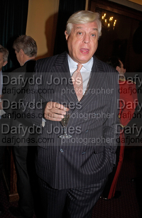 John Simpson, Reception to support the Hyde Park Appeal for Liberty Drives ( a charity which enables people to travel around Hyde Park in electric buggies) in the presence of Prince Michael of Kent. Officers Mess. Household Cavalry Mounted Regiment. Hyde Park Barracks. 30 November 2004. ONE TIME USE ONLY - DO NOT ARCHIVE  © Copyright Photograph by Dafydd Jones 66 Stockwell Park Rd. London SW9 0DA Tel 020 7733 0108 www.dafjones.com