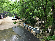 Ellicott City, Maryland - May 27, 2018: River water jumps the roads and parking lots in Historic Ellicott City.<br /> <br /> Historic Ellicott City Maryland was destroyed by floodwaters Sunday May 27, 2018 -- the same day of Kristen Rigney and Craig Cymbor's wedding at Main Street Ballroom in Ellicott City. Their wedding venue flooded minutes before their ceremony was scheduled and the entire wedding party fled to La Palapa, the Mexican food restaurant upstairs, where Craig and Kristen said their vows. Instead of eating, drinking and dancing, the wedding party, watched cars get swept away. <br /> CREDIT: Matt Roth