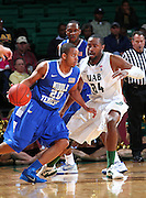 Dec 07, 2011; Birmingham, AL, USA;  Middle Tennessee Blue Raiders guard Jimmy Oden (20) controls the ball as UAB Blazers guard Preston Purifoy (24) guards him at Bartow Arena. The Blazers defeated the Blue Raiders 66-56 Mandatory Credit: Marvin Gentry-