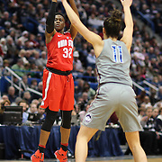 HARTFORD, CONNECTICUT- DECEMBER 19: Shayla Cooper #32 of the Ohio State Buckeyes shoots for three while defended by Kia Nurse #11 of the Connecticut Huskies during the UConn Huskies Vs Ohio State Buckeyes, NCAA Women's Basketball game on December 19th, 2016 at the XL Center, Hartford, Connecticut (Photo by Tim Clayton/Corbis via Getty Images)
