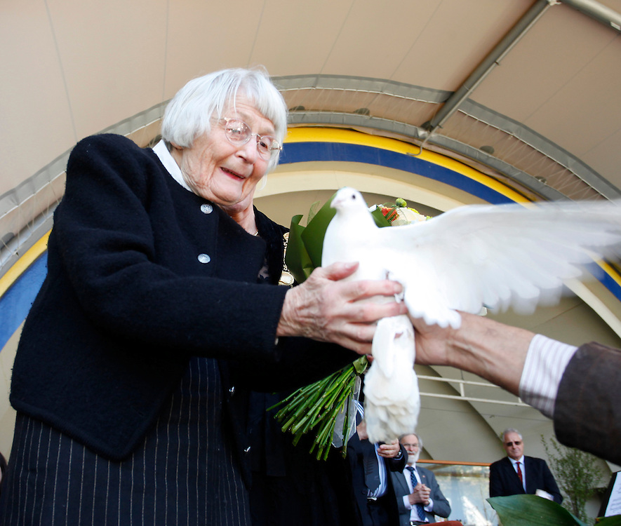 Jean Hubbard releasing a dove in memory of her husband Allan Hubbard, who died in a car crash in September, at the Memorial Service for him, held at the  Sound Shell, Timaru, New Zealand, Sunday, October 09, 2011. Credit:SNPA / Pam Johnson