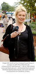 Singer KIM WILDE at the Chelsea Flower Show in London on 20th May 2002.PAD 20