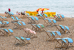 © Licensed to London News Pictures. 26/05/2018. Brighton, UK. deckchairs stand unused on the beach in brighton and Hove as fewer people than expected are visiting the seaside resort on the bank holiday weekend Saturday. Photo credit: Hugo Michiels/LNP