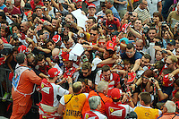 (L to R): Kimi Raikkonen (FIN) Ferrari and team mate Fernando Alonso (ESP) Ferrari sign autographs for the fans in the pit lane.<br /> Italian Grand Prix, Thursday 4th September 2014. Monza Italy.
