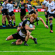 Finlay Christie reaching out to score during the Super Rugby union game between Hurricanes and Sunwolves, played at Westpac Stadium, Wellington, New Zealand on 27 April 2018.   Hurricanes won 43-15.