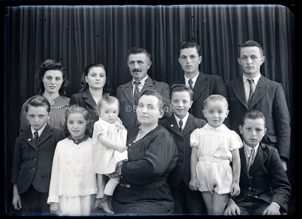 large family group studio portrait France circa 1930s