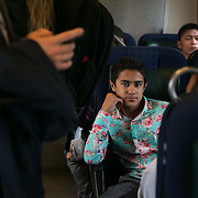 A young refugee on the train to Sweden from Denmark.  An unprecedented number of refugees arrived from Germany in early September, most being Syrian war refugees, some from Afghanistan. Most wanted to travel on to Sweden and a number of Danish citizens created a spontanious network to assist the refugees with travel, food, clothes and psycological support.