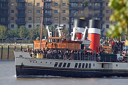 © Licensed to London News Pictures. 12/10/2013. Last sea going paddle steamer Waverley approaching Greenwich. Passengers enjoyed an unexpectedly sunny day on board the famous paddle steamer Waverley on on her final days on the Thames this year. Credit : Rob Powell/LNP