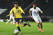 Coventry City midfielder (on loan from Aston Villa) Callum O'Hare (17) looks to release the ball under pressure from Milton Keynes Dons defender Joe Walsh (4) during the EFL Trophy match between Milton Keynes Dons and Coventry City at Stadium:MK, Milton Keynes, England on 3 December 2019.