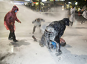 "People help Baek Nam-gi (bottom), 68, a farmer from Boseong, who fell down after being hit by a direct blast from a police water cannon during an anti-government protest in central Seoul, South Korea, November 14, 2015. Policemen continued to fire the water cannon containing capsaicin toward the farmer and other protesters while he was receiving assistance. ""The People's Camp for Rising Up and Fighting"", representing various groups of farmers, students, workers and the poor, demonstrated to oppose South Korean government's plans to change the labor market and monopolize the authorship of history textbooks. Policemen set up vehicle barriers and used water cannon to break up people. The organizer said 130,000 people participated in the demo, while the police said 68,000 attended. Baek Nam-gi who had remained in a coma at Seoul National University Hospital since being struck by a police water cannon during the anti-government protest on Nov. 14, 2015, died on September 25, 2016, local media reported. He was 69. Photo by Lee Jae-Won (SOUTH KOREA)"