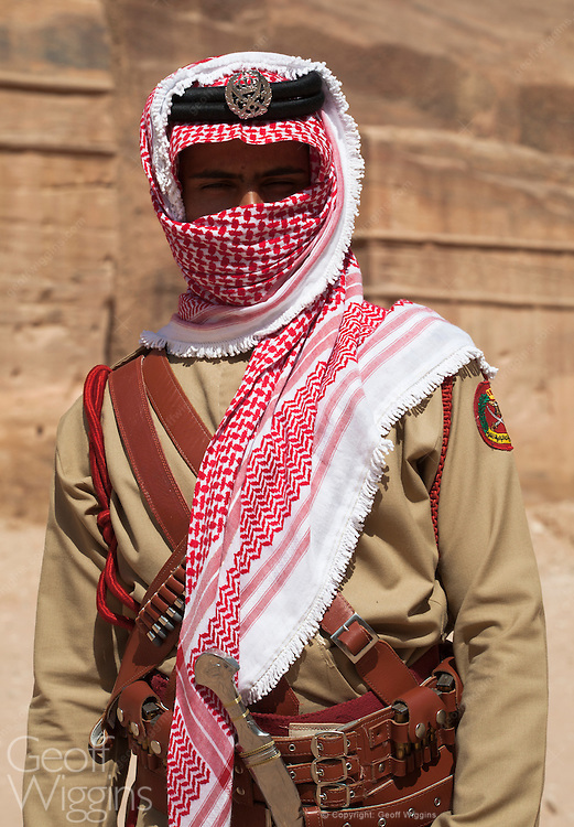 Bedouin police officer on guard at the ancient historic city of Petra, Jordan