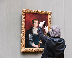 Visitor photographing a painting at Gemaldegalerie museum, at Kulturforum in Berlin, Germany