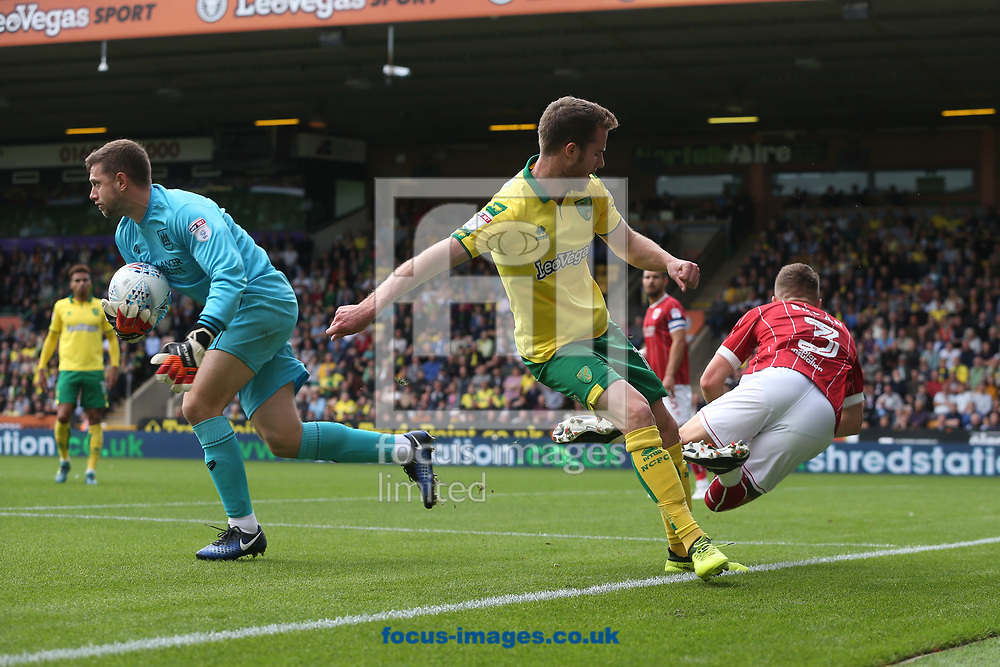 Frank Fielding of Bristol City collects the ball safely ahead of Marley Watkins of Norwich who fouls Joe Bryan of Bristol City in the process during the Sky Bet Championship match at Carrow Road, Norwich<br /> Picture by Paul Chesterton/Focus Images Ltd +44 7904 640267<br /> 23/09/2017