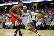 Apr 19, 2010; Cleveland, OH, USA; Cleveland Cavaliers guard Mo Williams (2) tries to drive around Chicago Bulls guard Derrick Rose (1) during the second period in game two in the first round of the 2010 NBA playoffs at Quicken Loans Arena. Mandatory Credit: Jason Miller-US PRESSWIRE