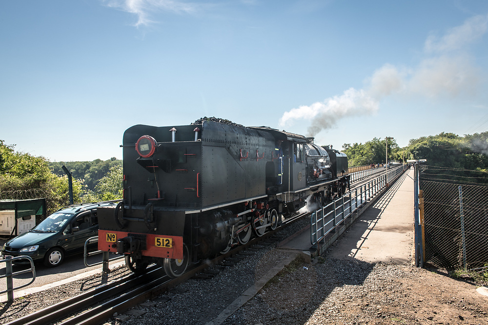 A Garratt steam locomotive crossing the Victoria Falls Bridge. Zimbabwe