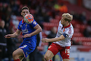 Sheffield United defender James McEveley  and Oldham Athletic forward Jake Cassidy  during the The FA Cup match between Sheffield Utd and Oldham Athletic at Bramall Lane, Sheffield, England on 5 December 2015. Photo by Simon Davies.