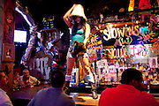 Bartenders dance on the bar at Coyote Ugly on East 6th Street in Austin Texas in June 2010.