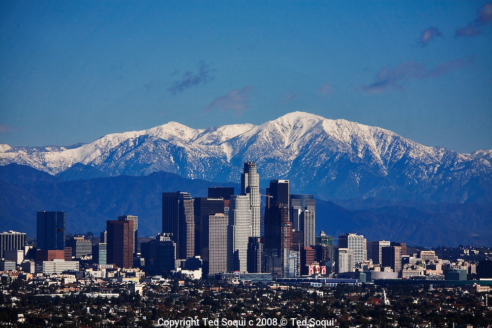 View of Downtown Los Angeles with a snow capped Mt. Baldy of the San Gabriel Mountain Range in the background..