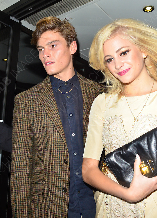 16.SEPTEMBER.2012. LONDON<br /> <br /> PIXIE LOTT AND OLIVER CHESHIRE ATTEND THE TEMPERLEY LFW CATWALK SHOW.<br /> <br /> BYLINE: EDBIMAGEARCHIVE.CO.UK/JOE ALVAREZ<br /> <br /> *THIS IMAGE IS STRICTLY FOR UK NEWSPAPERS AND MAGAZINES ONLY*<br /> *FOR WORLD WIDE SALES AND WEB USE PLEASE CONTACT EDBIMAGEARCHIVE - 0208 954 5968*
