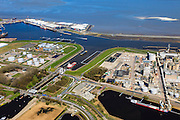 Nederland, Groningen, Delfzijl, 01-05-2013; zeesluis van het Eemskanaal gezien naar het zeehavenkanaal. Links de haven van Delfzijl, rechts het Chemiepark met Akzo-Nobel, de Eems in de achtergrond. Oietanks. De sluis maakt onderdeel uit van de vaarroute Lemmer-Delfzijl<br /> Sealock of the Eemskanaal, the port of Delfzijl.<br /> luchtfoto (toeslag op standard tarieven);<br /> aerial photo (additional fee required);<br /> copyright foto/photo Siebe Swart