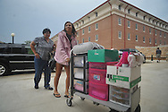 Incoming freshman Olivia Battle of Batesville, Miss., with her mother Ollie, moves her belongings into a dorm as students began moving in at the University of Mississippi in Oxford, Miss. on Wednesday, August 17, 2011. Classes for the fall semester begin Monday, August 22, 2011.