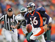 DENVER - OCTOBER 30:  Quarterback Jake Plummer #16 of the Denver Broncos runs away from safety Michael Lewis #32 of the Philadelphia Eagles as he leads his team to a big win against the Eagles on October 30, 2005 at INVESCO Field at Mile High in Denver, Colorado. The Broncos defeated the Eagles 49-21. ©Paul Anthony Spinelli *** Local Caption *** Jake Plummer;Michael Lewis