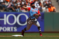 SAN FRANCISCO, CA - AUGUST 26: Rougned Odor #12 of the Texas Rangers throws to first base to complete a double play against the San Francisco Giants during the fifth inning at AT&T Park on August 26, 2018 in San Francisco, California. The San Francisco Giants defeated the Texas Rangers 3-1. All players across MLB will wear nicknames on their backs as well as colorful, non-traditional uniforms featuring alternate designs inspired by youth-league uniforms during Players Weekend. (Photo by Jason O. Watson/Getty Images) *** Local Caption *** Rougned Odor