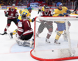 15.05.2012, Ericsson Globe, Stockholm, SWE, IIHF, Eishockey WM, Schweden (SWE) vs Lettland (LVL), im Bild Sverige Sweden 33 Jakob Silfverberg scores a goal, Sverige Sweden 27 Patric Hörnqvist, Latvia 1 Goalkeeper Maris Jucers (Dinamo Riga) // during the IIHF Icehockey World Championship Game between Schweden (SWE) vs Latvia (LVL) at the Ericsson Globe, Stockholm, Sweden on 2012/05/15. EXPA Pictures © 2012, PhotoCredit: EXPA/ PicAgency Skycam..***** ATTENTION - OUT OF SWE *****
