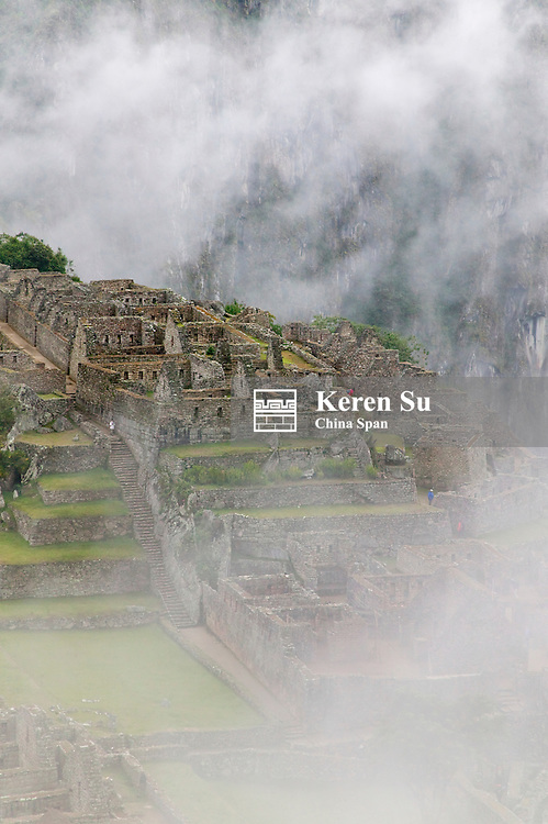 Ancient ruins of Machu Picchu in the Andes Mountain in early morning mist, Peru