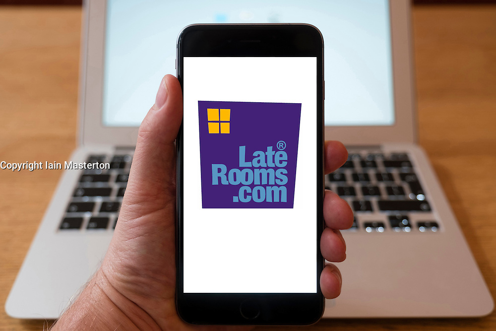 Using iPhone smartphone to display logo of LateRooms,com hotel room booking website