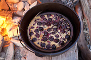 Cherry clafoutis baked in a Dutch oven on the beach, Little Compton, Rhode Island.