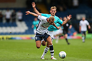 Bury's Adam Thompson and Forest Green Rovers George Williams(11) battle for the ball during the EFL Sky Bet League 2 match between Bury and Forest Green Rovers at the JD Stadium, Bury, England on 18 August 2018.