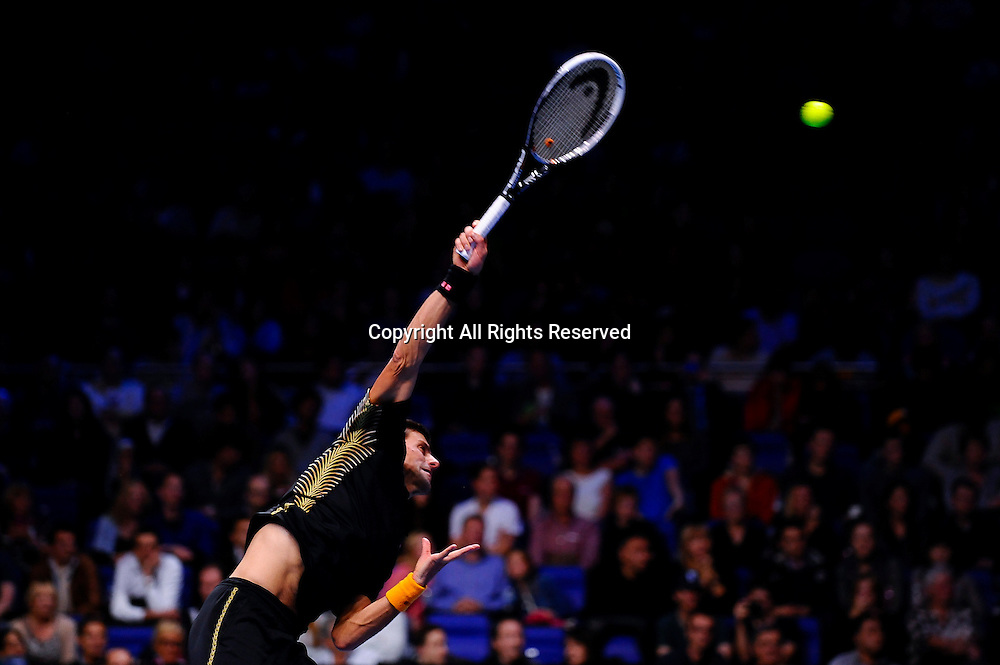 11.11.2012 London, England. Serbias Novak Djokovic serves against Argentinas Juan Martin del Potro during the first Semi Final of the Barclays ATP World Tour Finals at The O2 Arena.