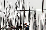 A migrant worker at a construction site in the suburbs of Hefei.