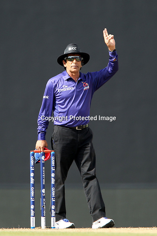 Umpire Asad Rauf signals to the batsman during the ICC World Twenty20 Super 8s match between England and New Zealand held at the  Pallekele Stadium in Kandy, Sri Lanka on the 29th September 2012<br /> <br /> Photo byRon Gaunt/SPORTZPICS/PHOTOSPORT