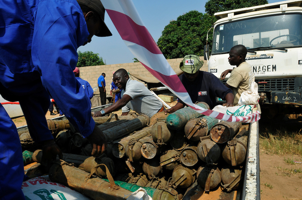 A technical demining team from Mines Advisory Group (MAG) loading a truck with a stockpile of weapons and ammunition recovered by the Angolan police and given to MAG to destroy. The weapons and ammunition will be transported to a site outside of town for a controlled demolition..Luena, Angola. 30/09/2010..Photo © J.B. Russell