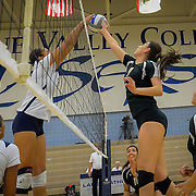 Irvine Valley's Kylie Miller blocks the spike of Golden West's Samantha Ureno  during the match played in Irvine, California, Friday, Nov 4, 2016. Photo By: Bryan Woolston, Sports Shooter Academy
