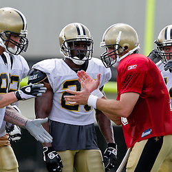 01 August 2009: New Orleans Saints quarterback Drew Brees (9) breaks from the huddle with teammates Jeremy Shockey (88), Reggie Bush (25) and Heath Evans (44) during New Orleans Saints training camp at the team's practice facility in Metairie, Louisiana.