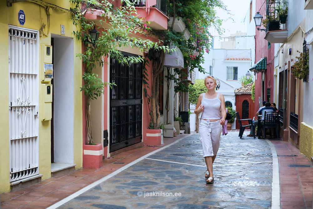 Woman walking in Marbella Old Town, Costa Del Sol, Spain