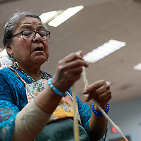 Lois Becenti teams a wool workshop at the Navajo Nation Museum in Window Rock Wednesday.