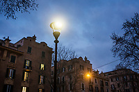 ROME, ITALY - 20 MARCH 2017: (L-R) A white light LED lamppost and a yellow light sodium lamppost are seen here in the Coppedè neighborhood in Rome, Italy, on March 20th 2017.<br /> <br /> Rome is undergoing a city-wide plan to change its public illumination from the current yellow sodium street lights CK to white LED lamps. In making the change, Rome joins a long line of cities around the world that have switched to the cheaper, and more environmentally friendly LED lighting, and it is not the first city where that change has come at the price of protest.<br /> <br /> Since July, some 100,000 led lights have already been installed, just over half the number that will be substituted in the 53 million euro changeover that is expected to save the city millions of euros in electrical bills. But when Rome's municipal electrical utility ACEA began to substitute the lamps in Rome's historic center, residents began to take note.