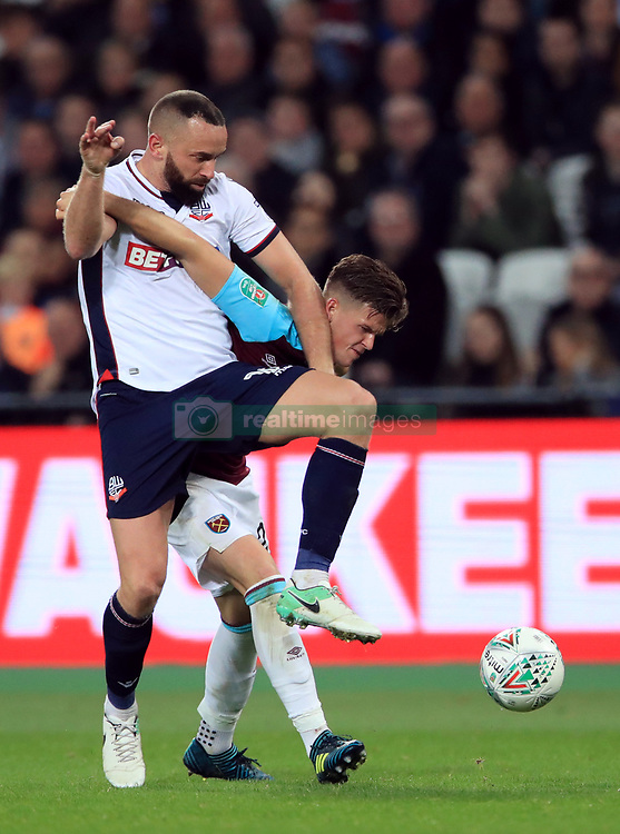 Bolton Wanderers' Aaron Wilbraham, left battle for the ball with West Ham United's Sam Byram, right