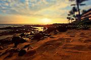 setting sun on the shores of Kona Beach in Hawaii