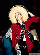 Girl selling shots wearing a sombrero Ibiza 1998