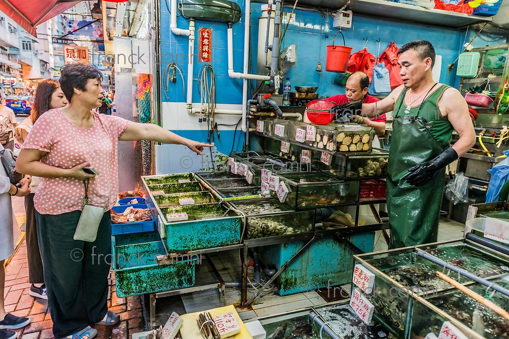 Causeway Bay, Hong Kong, China- June 4, 2014: people shopping at the seafood market