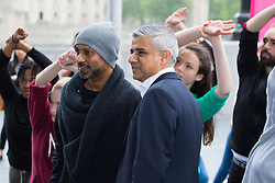 City Hall, London, May 19th 2016. PICTURED: Mayor of London Sadiq Khan poses with renowned choreographer Akram Khan.<br /> <br /> The Mayor of London Sadiq Khan joins internationally-celebrated choreographer Akram Khan and Londoners from across the capital as they do their warm-ups at City Hall for the international Big Dance Pledge.<br />  <br /> The preview of the performance ahead of the world-wide Big Dance event. On Friday 20 May, over 40,000 people in 43 countries around the world will take part in the dance, which has been specially choreographed by Akram Khan.