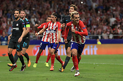 Atletico Madrid's Antoine Griezmann celebrates after scoring his side's first goal