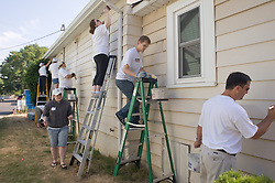Community volunteers join REACH CDC in helping homeowners in the Lents neighborhood of Portland by painting, patching and doing various home repairs.
