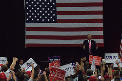 At the end of the rally the stage lights are turned off at while Republican presidential candidate DONALD TRUMP is still on the stage trying to greet voters at a rally in Mannheim, Lancaster County, PA , on October 1, 2016.